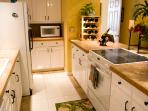 View of fully equipped kitchen.