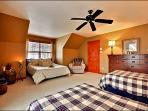 Bedroom with Two Twin Beds and One Queen Bed