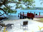 View of overwater deck and bay of islands from  Dugong Cottage