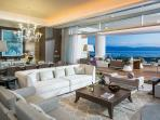 Relax in the living room with views of the Bay.