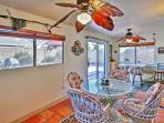 The Arizona room boasts a 4-person dining table and cooling ceiling fans.