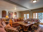 Lower Living Room has 3 Couches, Game Table, Hutch with Games