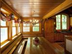 The banquette dining nook (seats up to 12)