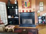 Den / Living area with gas fireplace, flat screen, extensive music and dvd collection