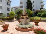 well maintained courtyard front of apartments gardens