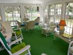 Large sunny porch with dining area.