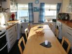 Fully equipped kitchen with views across the beach.