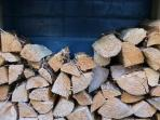 Logs are supplied for woodburning stove.