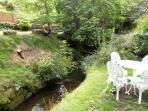Small stream behind cottage ideal for summer BBQs and relaxing.