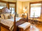 Master bedroom on first floor overlooks sunroom and porch