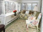 Twin bed in sunroom has birdseye view of Main Street