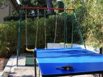 Swing set and table tennis table.