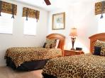 The Animal adult size twin bedroom with a TV and On Demand movies.