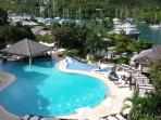Enjoy free use of two luxury pools, complimentary water, towels and poolside snacks to sample