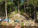 Shoreline during summer with a view of the steps leading down from the cottage.