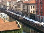Market on the Naviglio Grande (beautiful view from balcony).