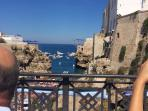 See the cliff  diving at Polignano a mare