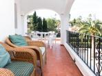 Balcony overlooking pool & gardens