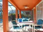 Sun Filled Lanai and Pool with ample table and chairs.