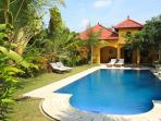 View from breakfast terrace on to the tropical garden & overflow swimming pool, and bungalows.