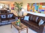 Living room with a sofa sleeper.