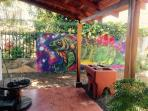 another view of back porch with Iguana art