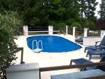 Our welcoming swimming pool (7m x 4m and 1.2m deep) with summerhouse featuring kitchenette and bbq.