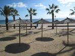 Beach has sun shades and loungers