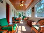 Lovely sunroom runs the full length of the cottage