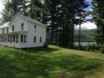 side lawn, lake to the right