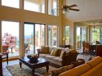 Living area with stunning deck and sea views. Direct T.V. a sofa bed for extra persons.
