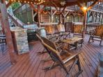 Outdoor entertaining with 55 inch, fireplace, gas grill and bar with seating for six