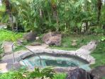Relax in sand-bottom jacuzzi at tropical upper pool while you grill dinner or sip tropical drinks