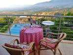...or a meal served to you on our balcony overlooking pool and wild Cretan scenery