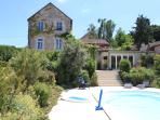 View of pool, up the stairs to summer kitchen and the main house.