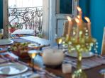 Set the table. The tall French doors open up to a small juliet balcony overlooking Calle Peru.
