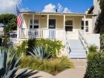 Sunset Cottage - relax and enjoy the comfortable front porch with ocean view.