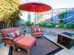 Garden Cottage - rear patio is gated and private and offers kick-your-feet-up comfort and lounging.