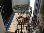 private balcony with garden chairs to enjoy the sunrise of Laguna de Bay with a cold bottle of beer