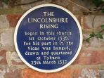 Plaque commemorating the Lincolnshire Rising, opposite south entrance to St James' Church, Louth.