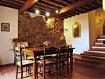 The dining area with exposed stone walls and traditional beamed ceilings