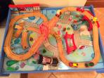 Trains and cars will play happily together on this track, the house is great for young children