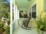 Enjoy morning coffee of happy hour on the serene front porch.