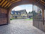 Entrance to secure courtyard, with view of main house