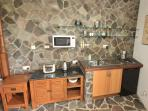 The Infinity Studio kitchenette with fridge,  gas hob, microwave, toaster and kettle