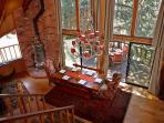 View from Loft of Dining Area and Vintage Wood Stove