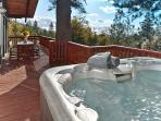 Spa and spacious deck with views