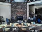 Dining room with views of the beautiful stone fireplace.