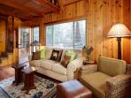 Secluded cozy wood cabin with wood flooring