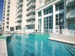 Outdoor pool and  hot tubs have view of Gulf